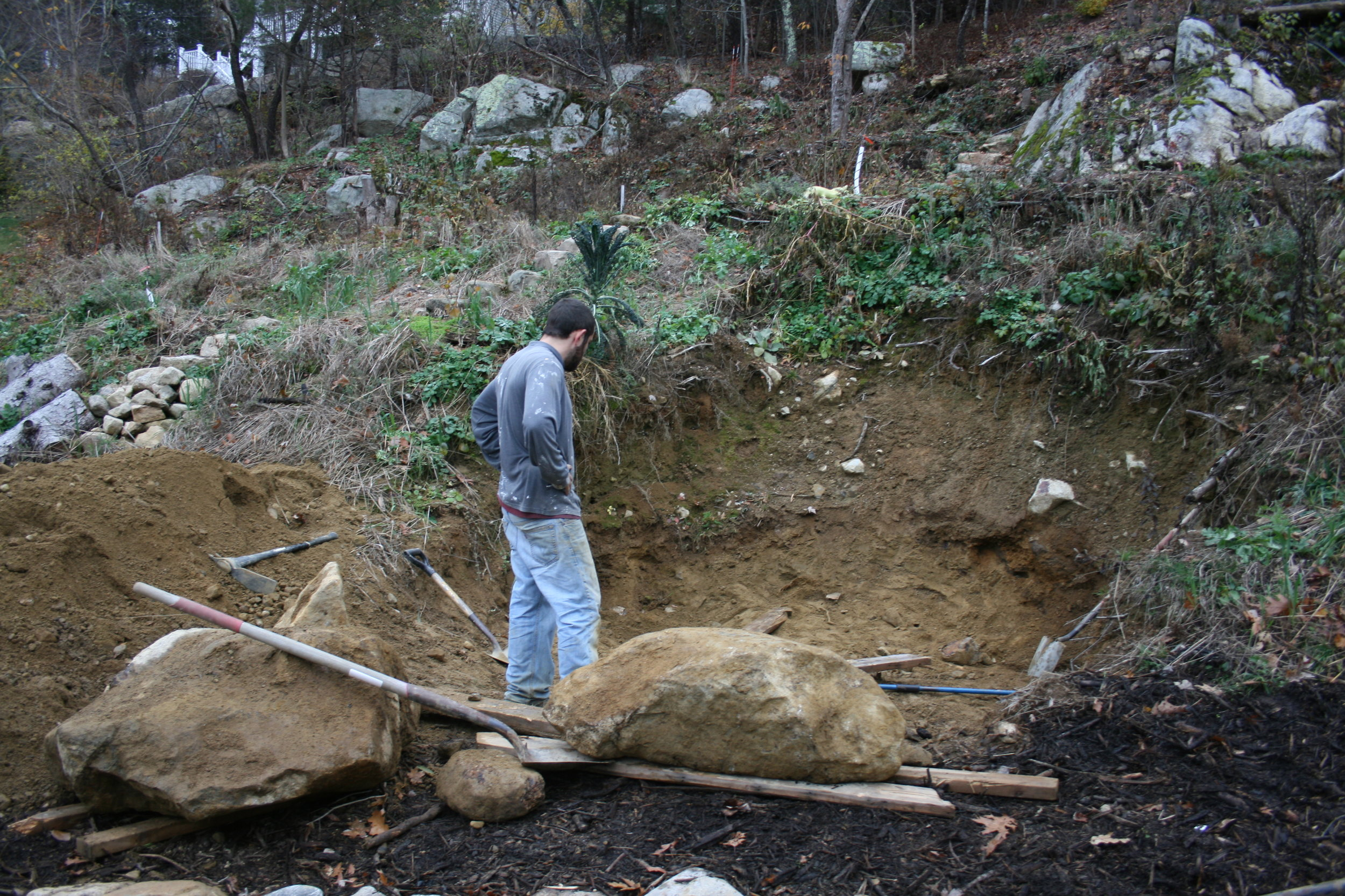 November 2016  Upon hand digging out the rest of the root cellar, we found these two stones…and had to move them together, by hand, using boards, shovels and a pry bar…