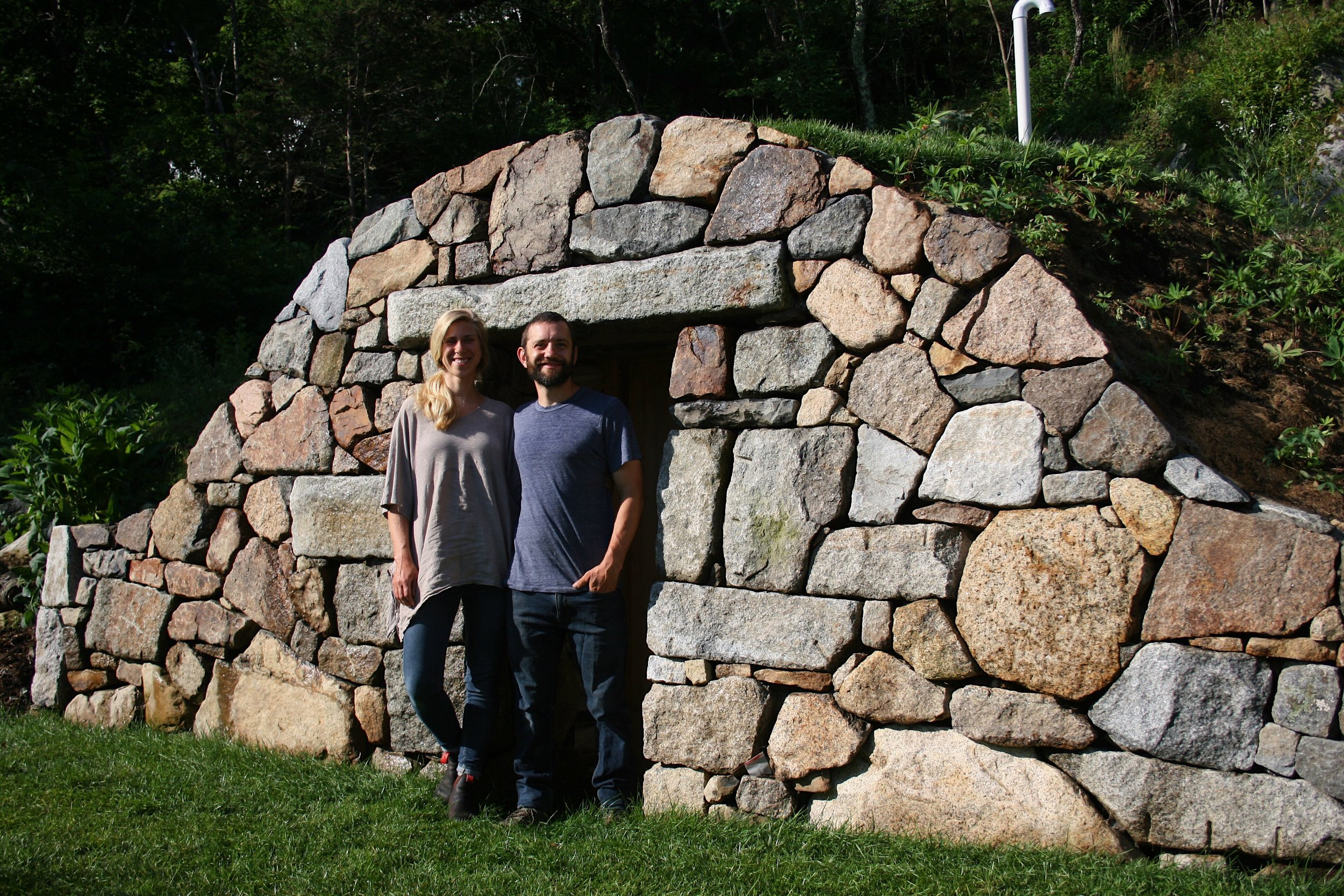July 2018  Us in front of the root cellar (mostly done, but still some details to go)