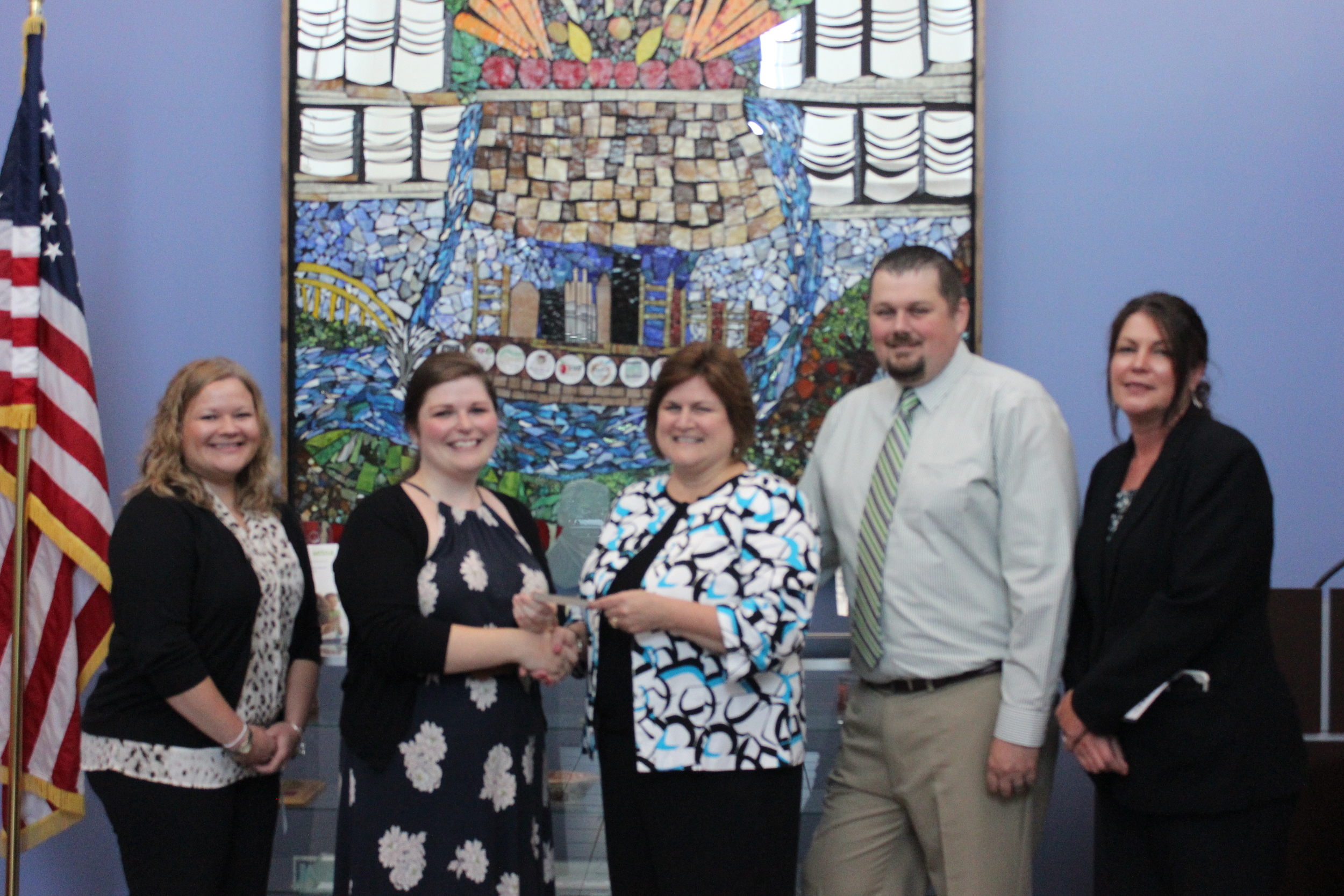 From left to right: Cranberry Township Branch Manager Danielle Little, Community Engagement and Volunteer Coordinator Beci Russell (from the Greater Pittsburgh Community Food Bank), Area Vice President of the Western Pennsylvania Region Lauran King, Monroeville Branch Manager Greg Brown, and Butler Branch Manager Bobbie Young.