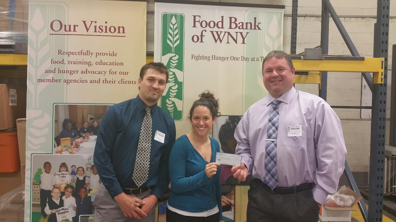 From left to right: Daniel Grenda, Branch Manager of the Mariner Finance Buffalo branch, the Public & Community Relation Coordinator of the Food Bank of WNY, and Brian Levis, AVP of the New York region for Mariner Finance.