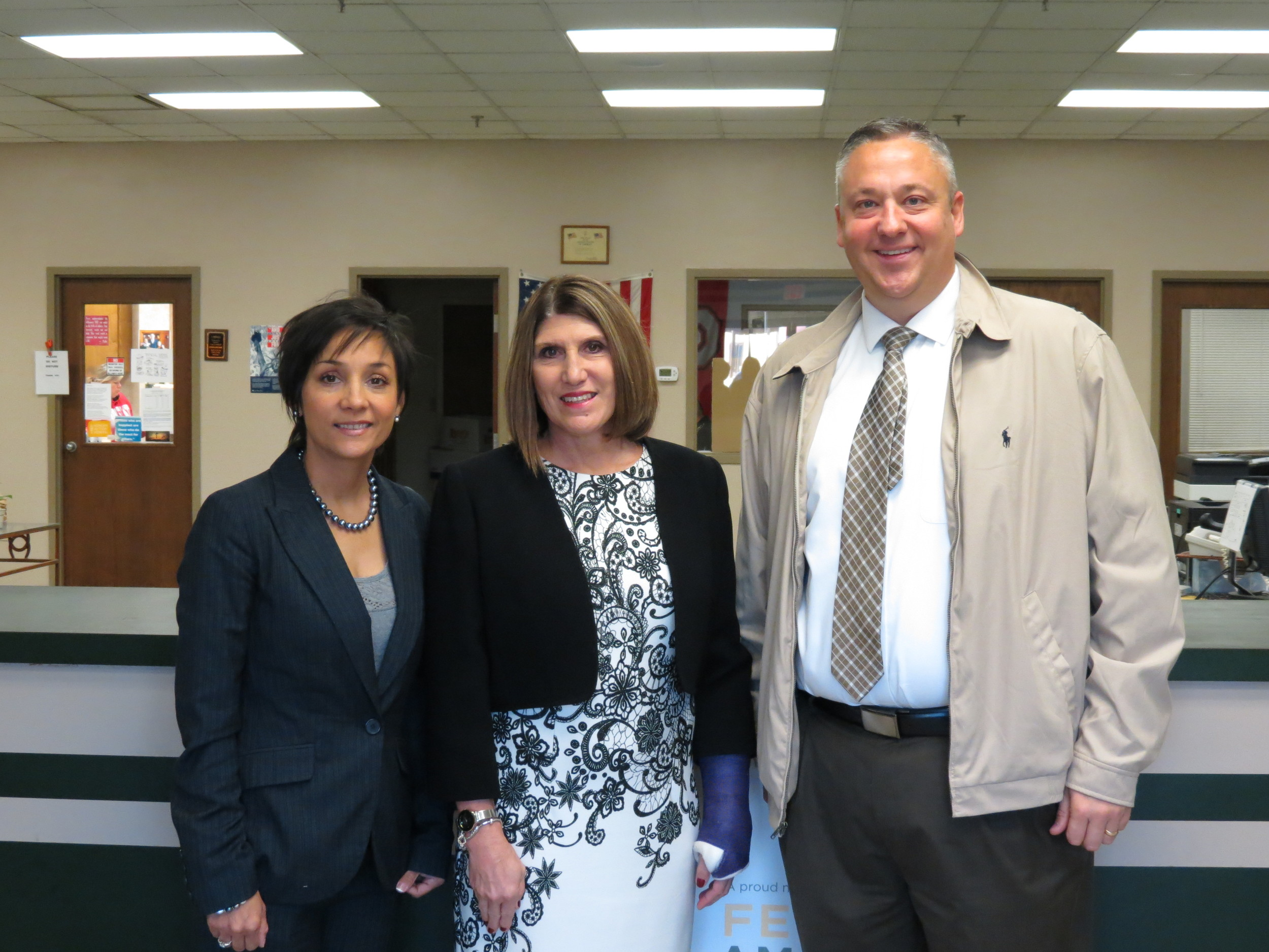 Rodney Coffey, AVP of the NW Ohio-Indianapolis Region, Linda Hamilton, CEO of the West Ohio Food Bank, and Regina Borja-Floyd, Lima, OH's Branch Manager