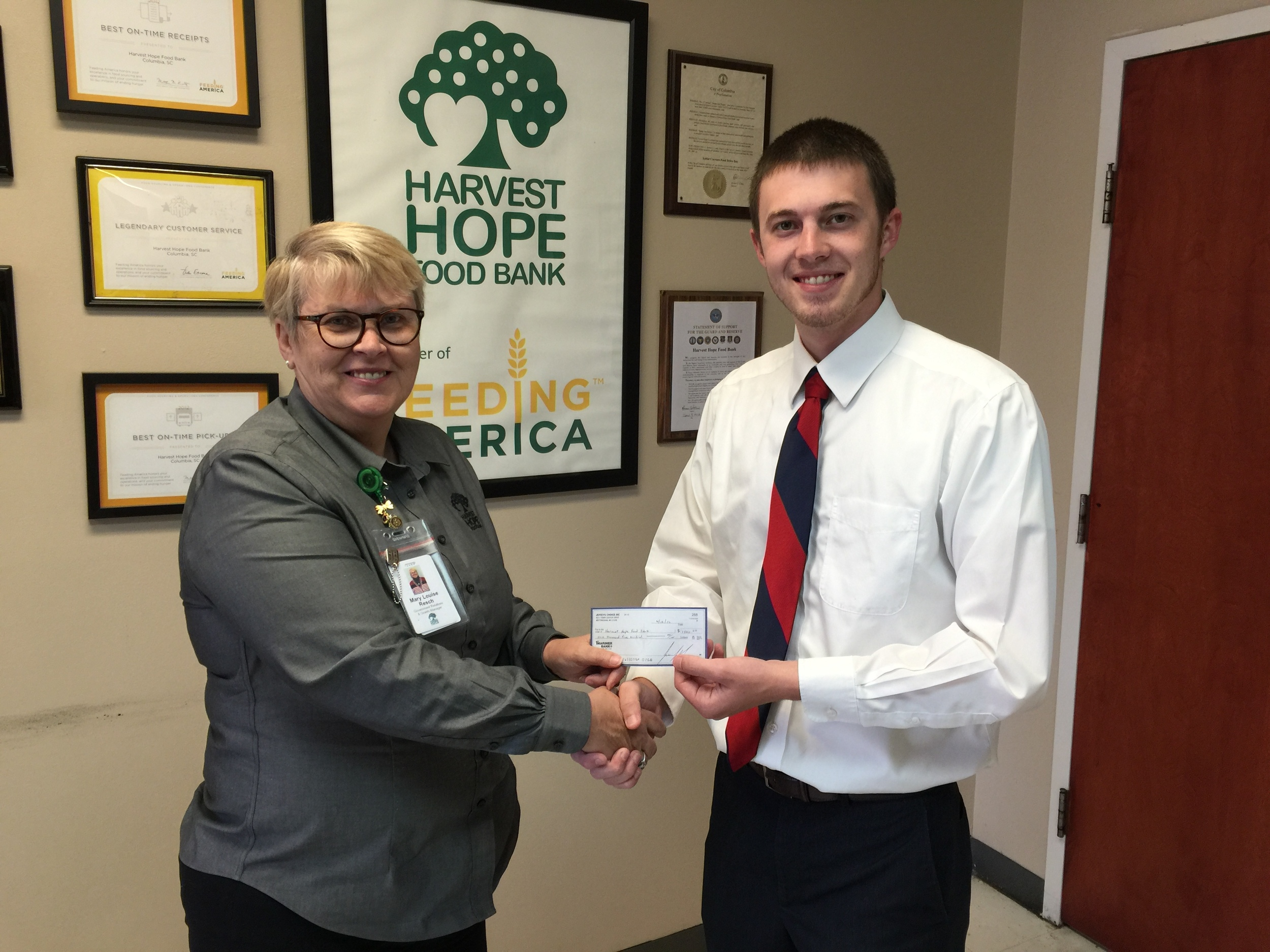Left to Right: Mary Louise Resch, Government Relations and Grants Manager at the Harvest Hope Food Bank and Jake Harper, Assistant Manager of the Pioneer Credit Company West Colombia, SC branch.