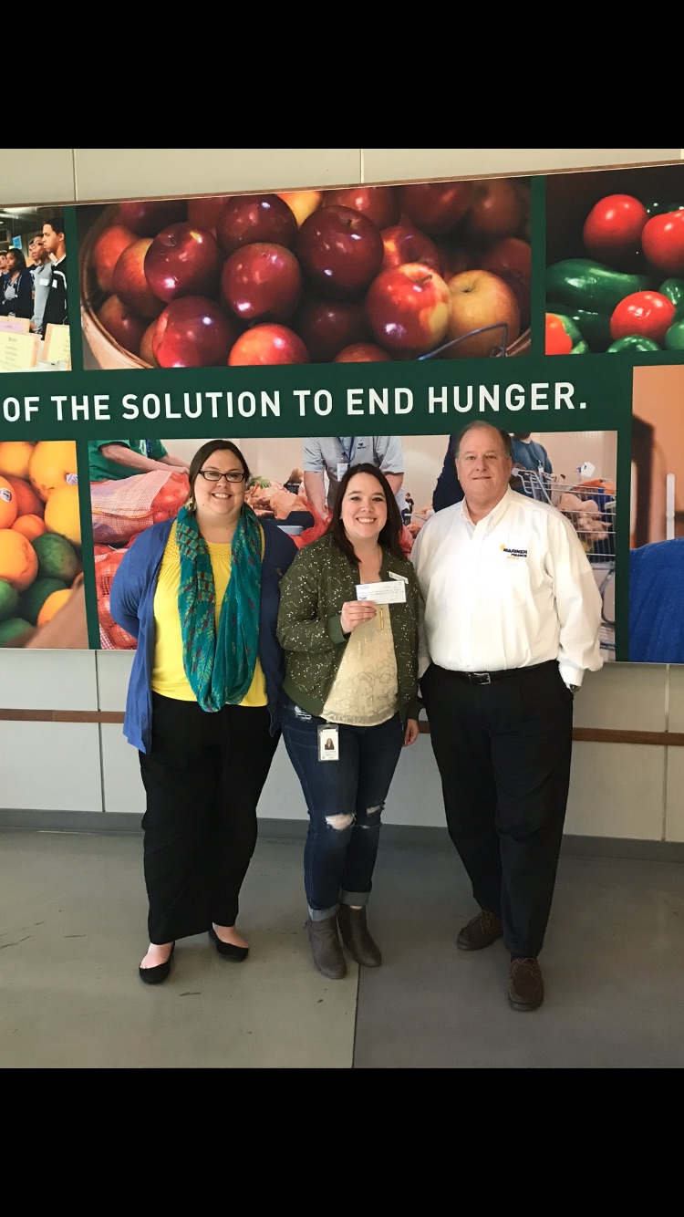 Pictured are Anne Rodriguez and Phillip Nevils of Mariner Finance delivering a $1,500 donation to the  Second Harvest Food Bank of Middle TN  on December 12, 2017.  Amanda M. Richard (Pictured center, Corporate Partnerships Manager of Second Harvest Food Bank) graciously accepted the donation.