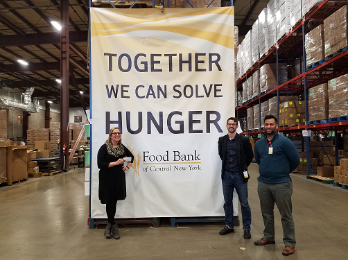 Eric and Ali delivered the donation to the Food Bank of Central NY.