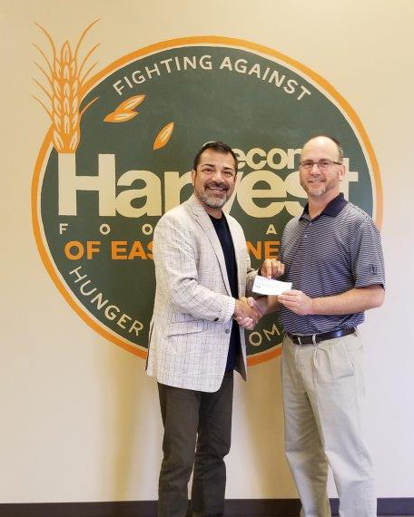 Pictured from left to right: Michael Torano - Director of Development at Second Harvest, Wes Killion - Branch Manager of Mariner Knoxville West location