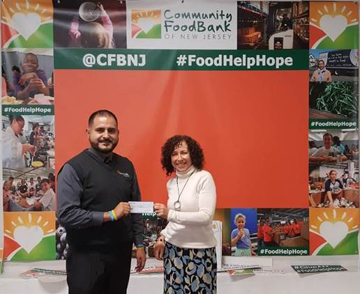 Pictured from left to right: Juan Aguilar, Branch Manager of Mariner Finance Union, NJ location, Debbie Scheinholtz, Community Food Bank of NJ