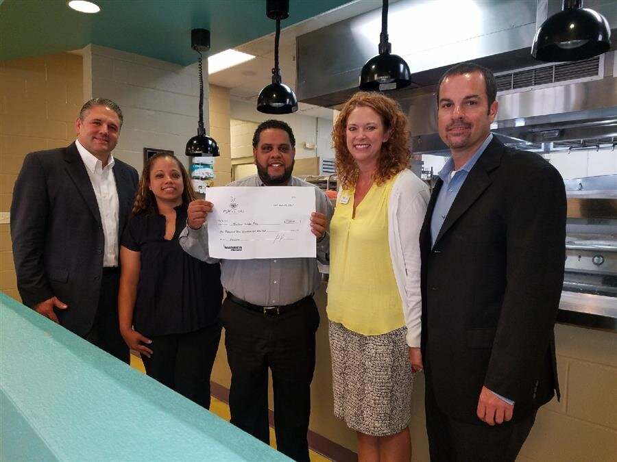 Pictured right to left: AVP Sean McCullough, Trinity Cafe Manager Mandy, Tampa West BM Jhonny Vidal, Tampa East BM Maria Peralta Heredia, VP Sal Scaffidi.