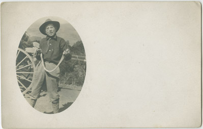 Tom Gatton with snake, location unknown, 1912