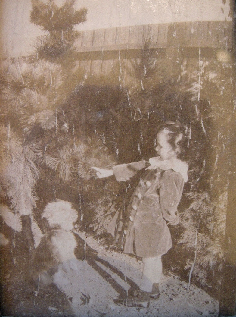 My dad always kept this photo on his desk. It is my stepmother training her childhood dog in Australia.