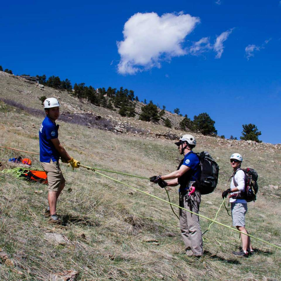 Members of Rocky Mountain Rescue Group man a brake / lowering station during the paraglider rescue operation in Boulder, Colorado.