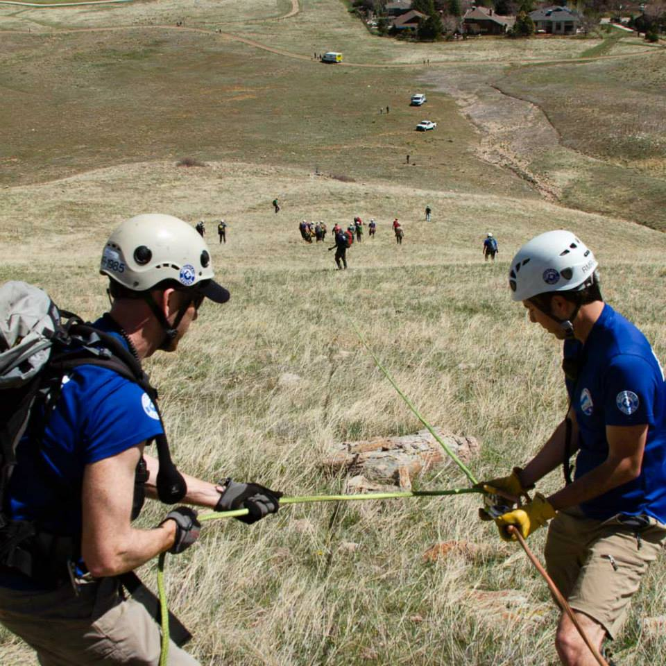 Looking down from the brake station, Rocky Mountain Rescue Group members perform a scree evacuation of an injured paraglider.