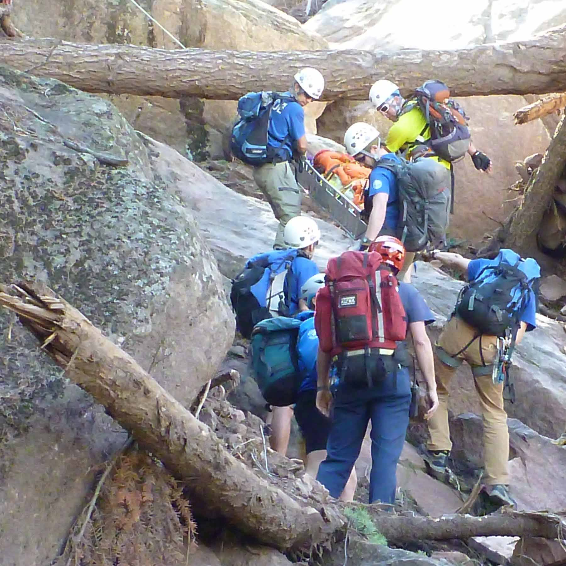 RMRG members conduct a litter evacuation down rugged, flood eroded terrain below the east face of Boulder's 2nd Flatiron.
