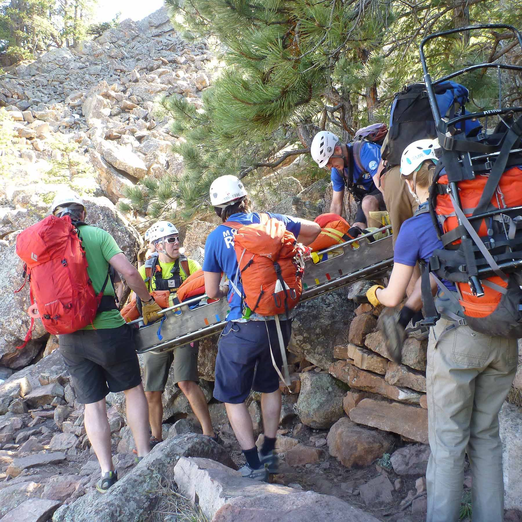 RMRG members approaching the lower scree field with rescued hiker securely in the litter.
