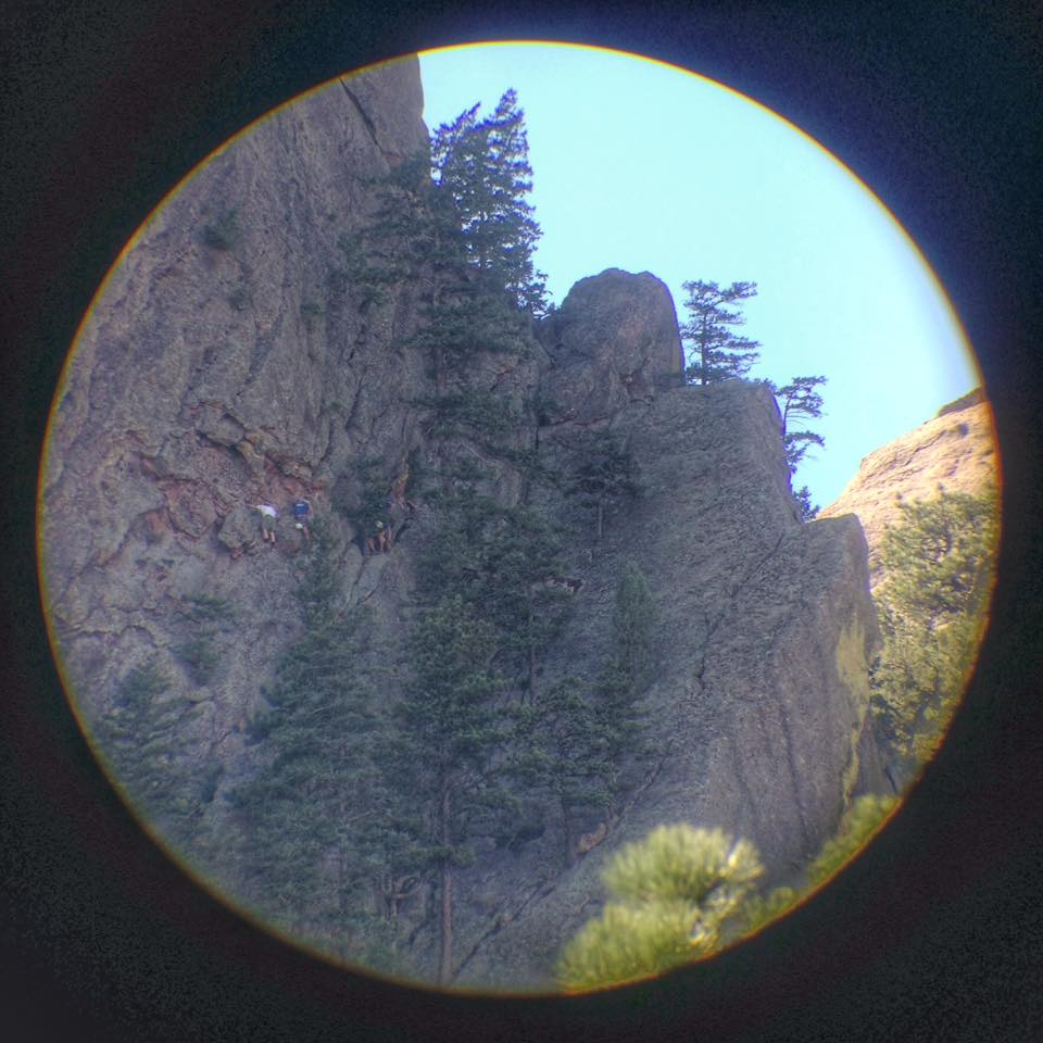 The stuck party (wearing white) and rescuers (wearing blue) as seen through a spotting scope at the Bluebell Shelter.