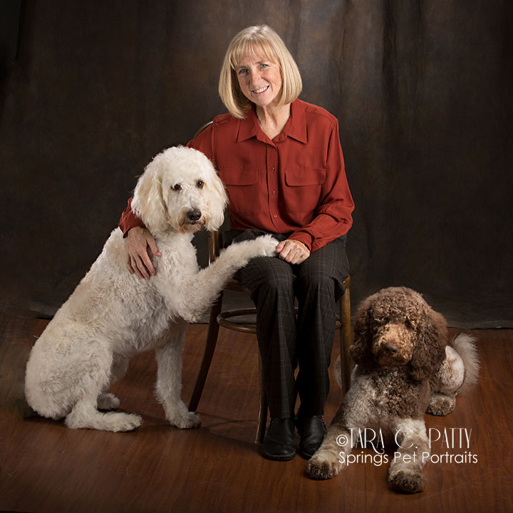 Owner with doodles in COlorado Springs best dog photographer