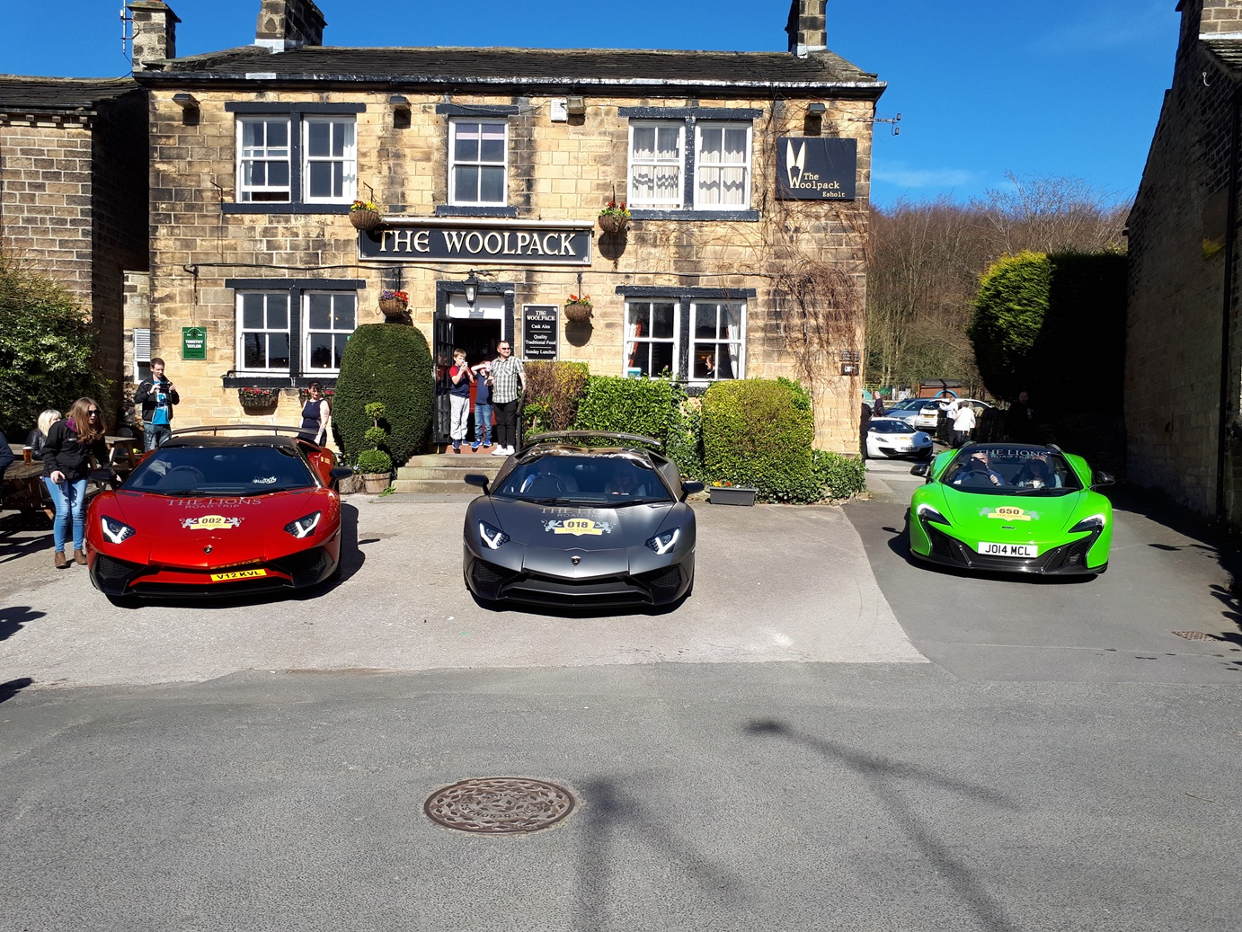 Supercars in front of pub.jpg