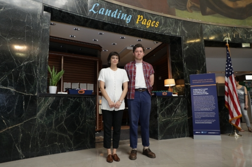 Lexie Smith and Gideon Jacobs in front of the Landing Pages kiosk at LaGuardia Airport's Marine Air Terminal (Credit PANYNJ - Brian Caraveo)
