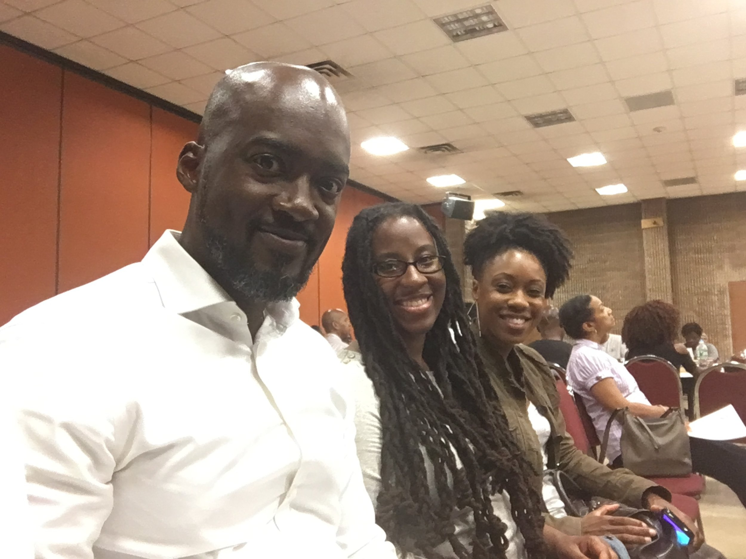 Molaundo, Sherese Francis, and Samantha Inniss at Community Board 12's monthly meeting