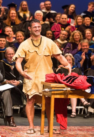Addressing Fall 2014 Convocation, Schindler shucked his academic regalia to reveal a hand-made deerskin tunic.
