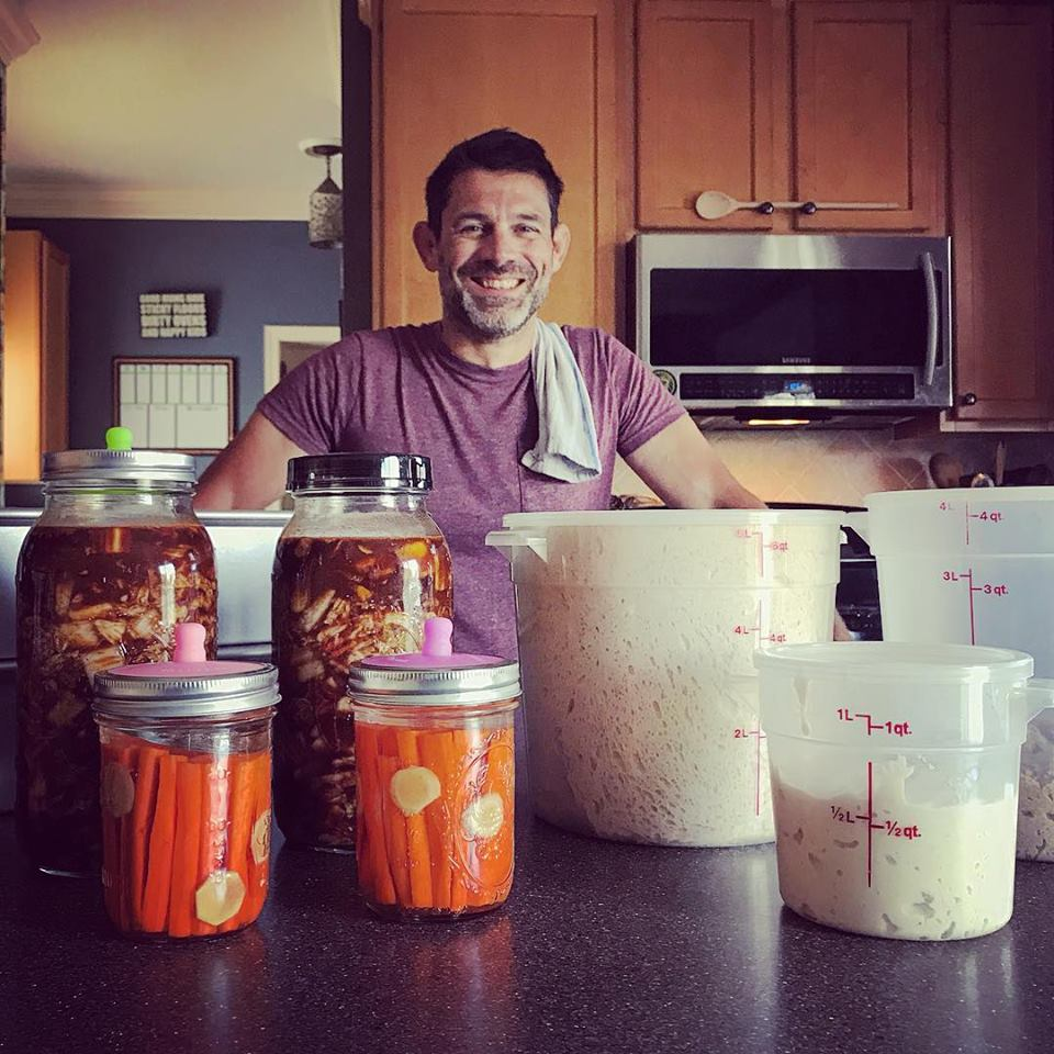 Getting ready for school lunches is nothing ordinary in our house! Kimchi and carrot sticks are fermenting. The sourdough bread, sandwich bread and Volkornbrot whole grain bread is rising. Yogurt is culturing. And this Dad is smiling because he's surrounded with all his bubbling jars!