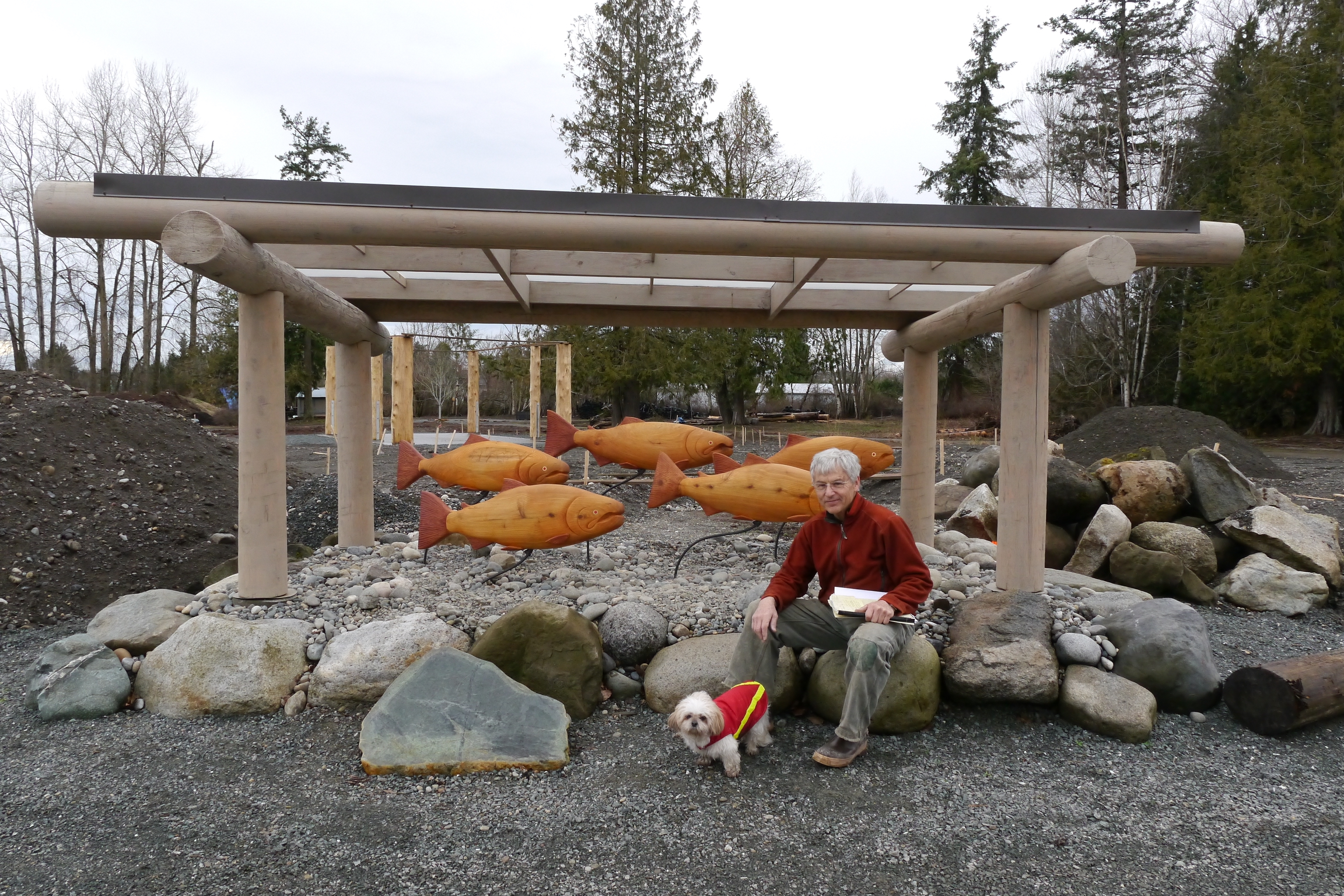 5 Salmon Sculpture swims proudly with its creator Mike McRory and his dog Zoe