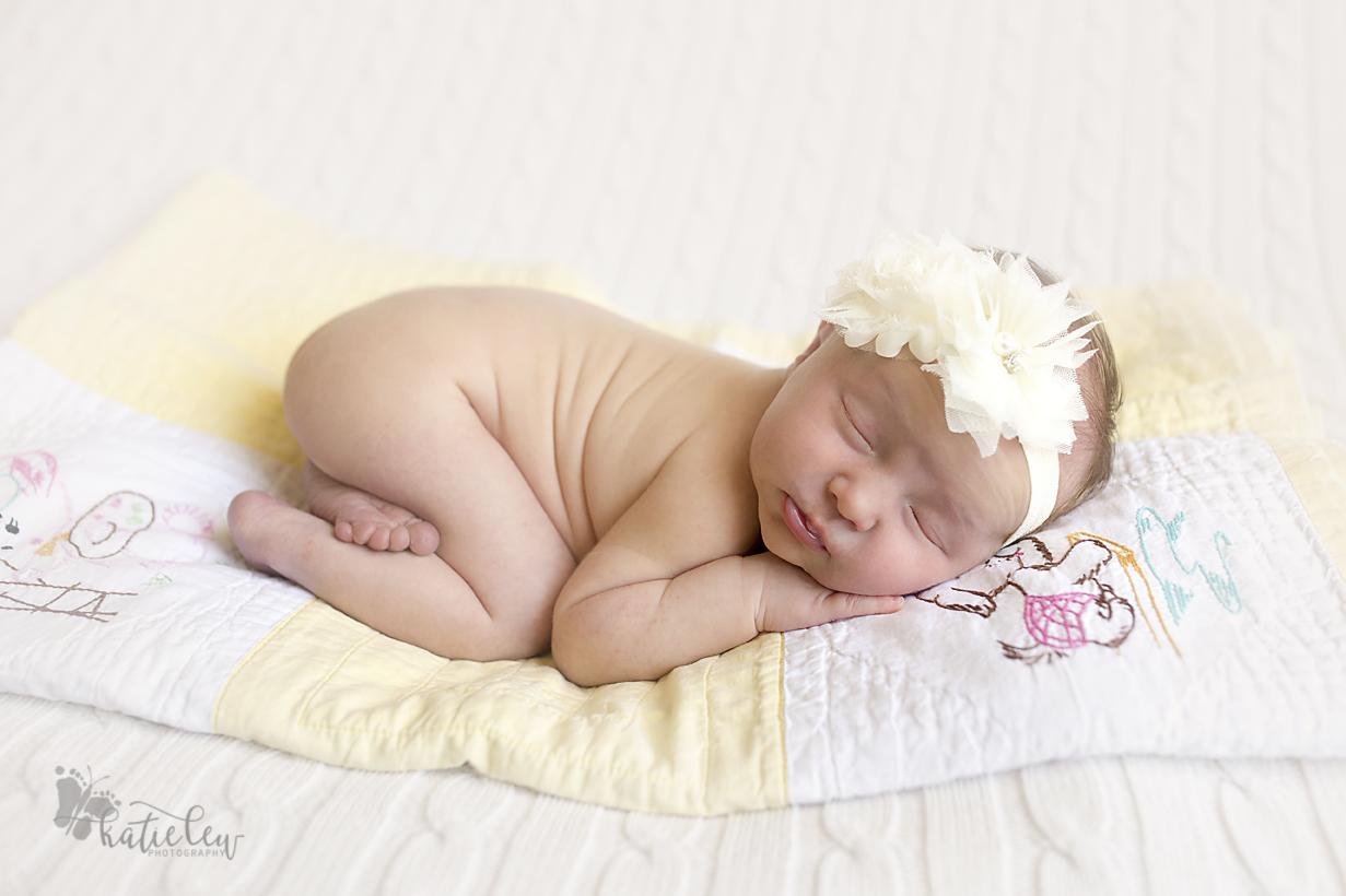 newborn baby girl bum up pose