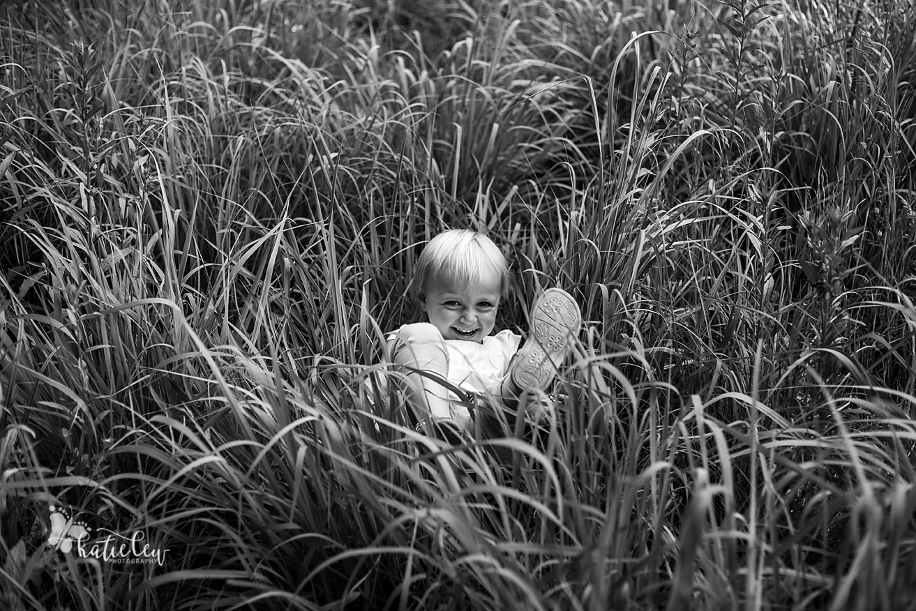 black and white in the grass