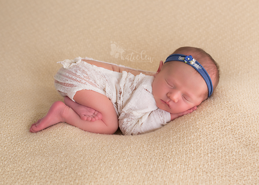 newborn baby girl at my studio in stillwater, ok wearing a lace romper
