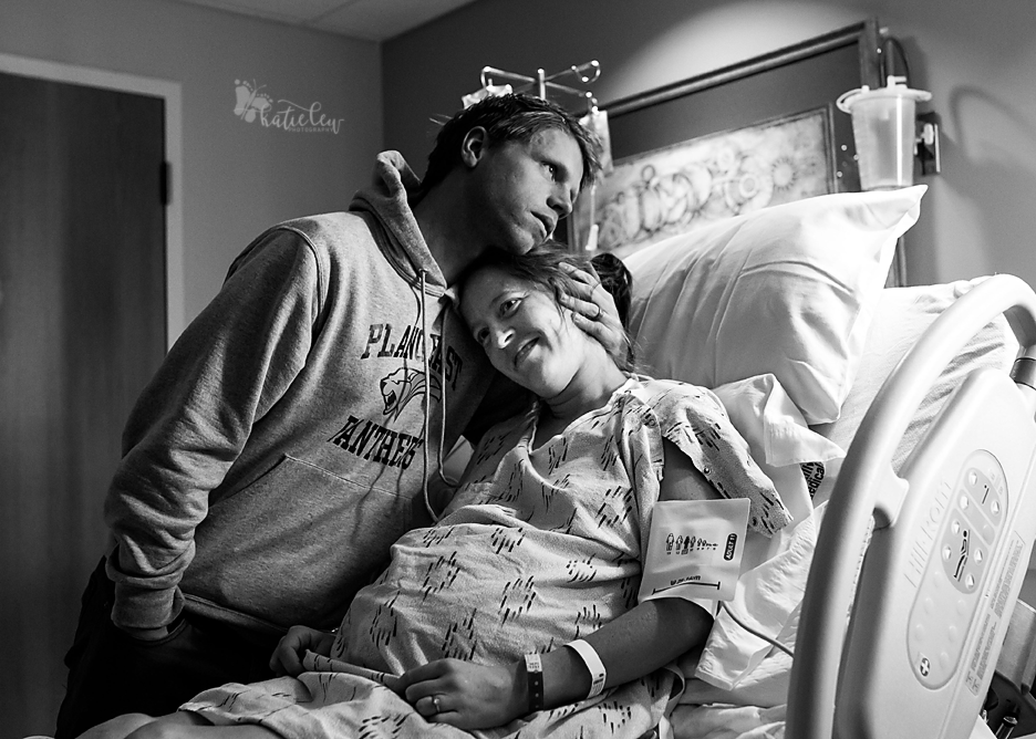 husband hugs his wife before she goes back for a cesarean section at stillwater medical center