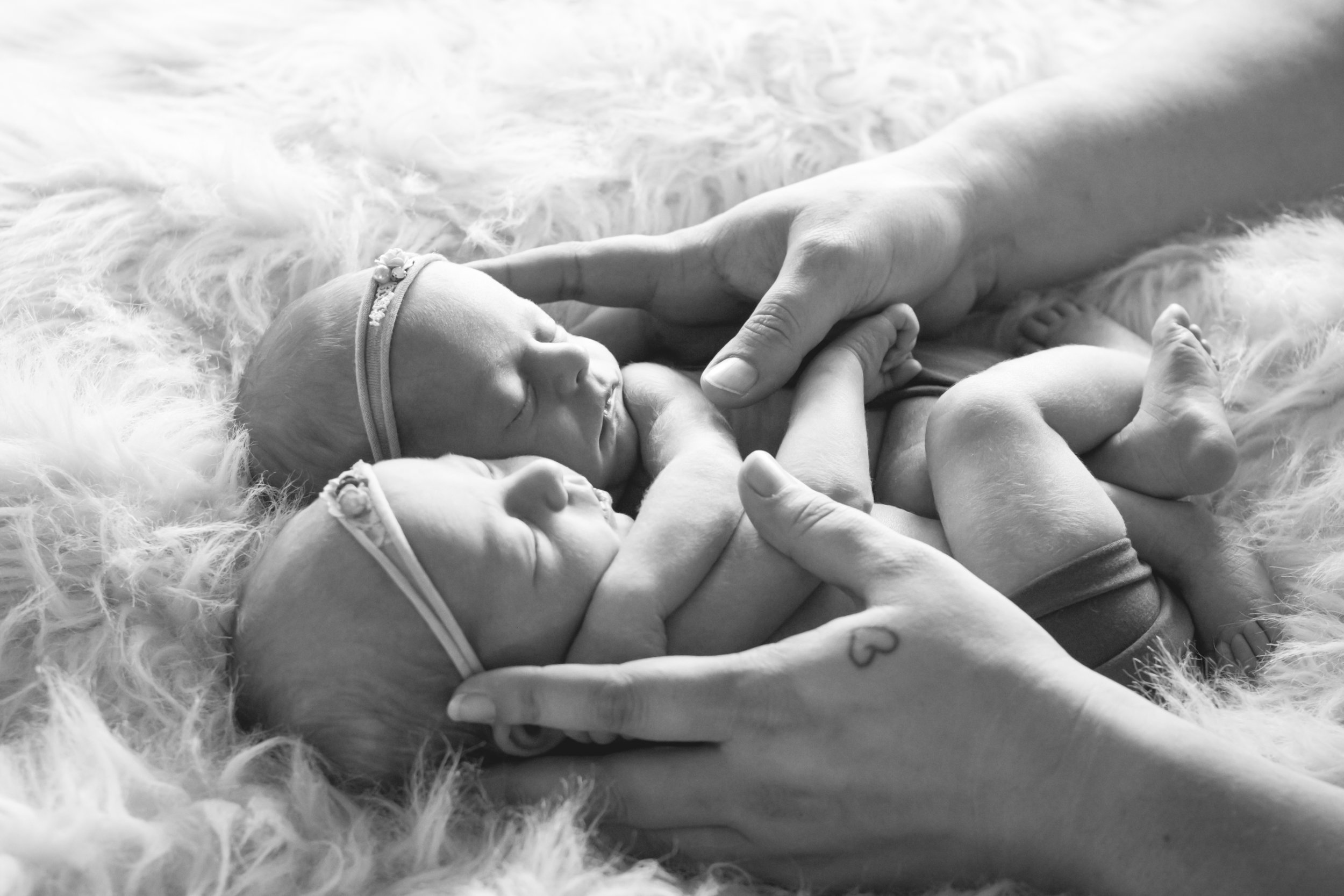 Katie of Katielew photography comforting twin baby girls