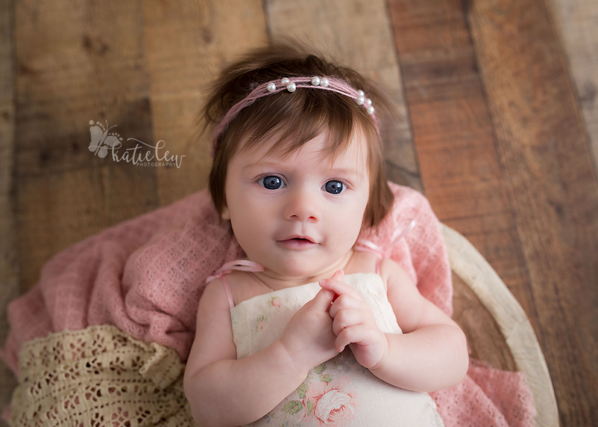 Stillwater baby photographer captures a curious face from this baby girl