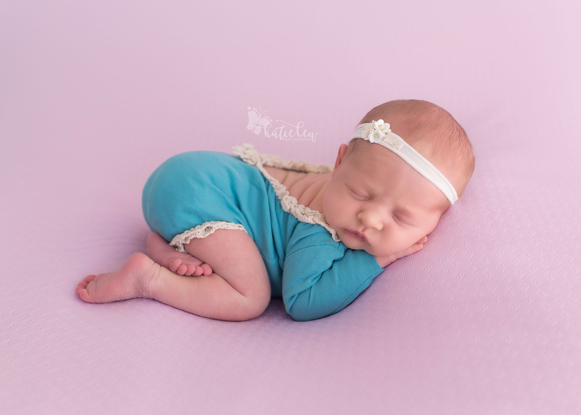 newborn girl in turquoise at a studio in stillwater, oklahoma.