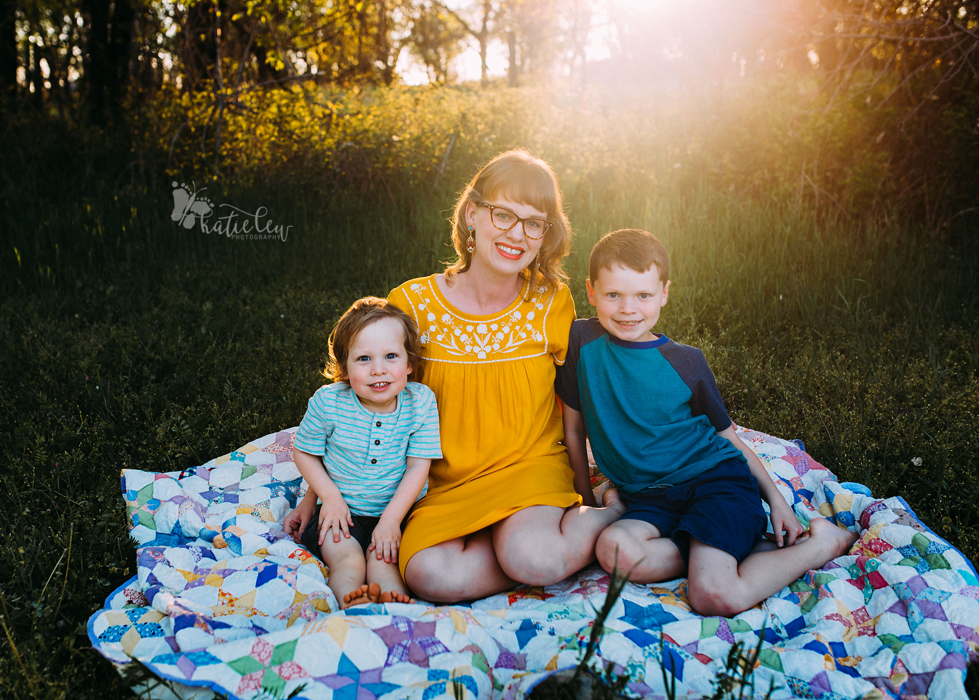 A mother and her two sons with a gorgeous sunflare