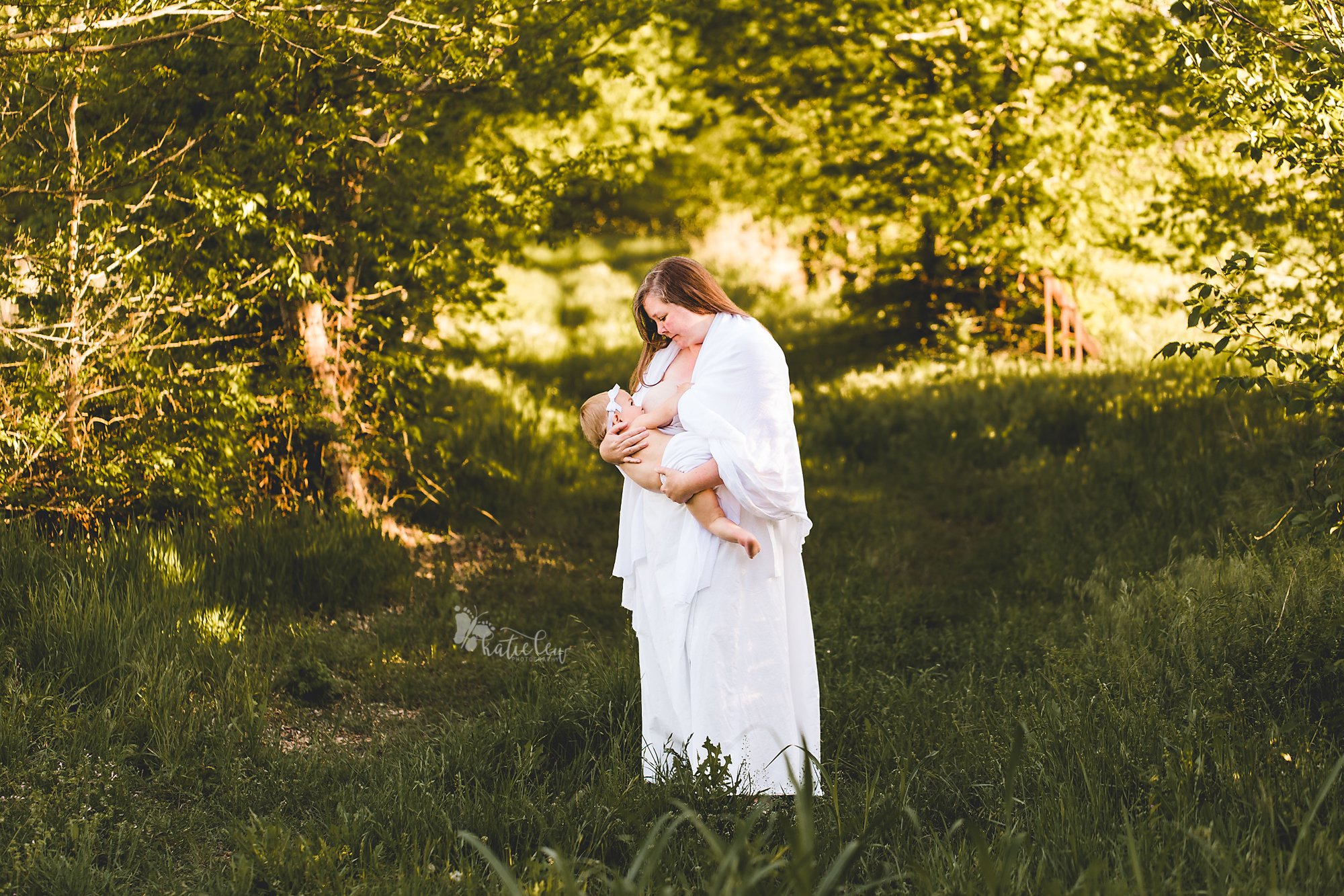 a mother dressed in white nurses her daughter