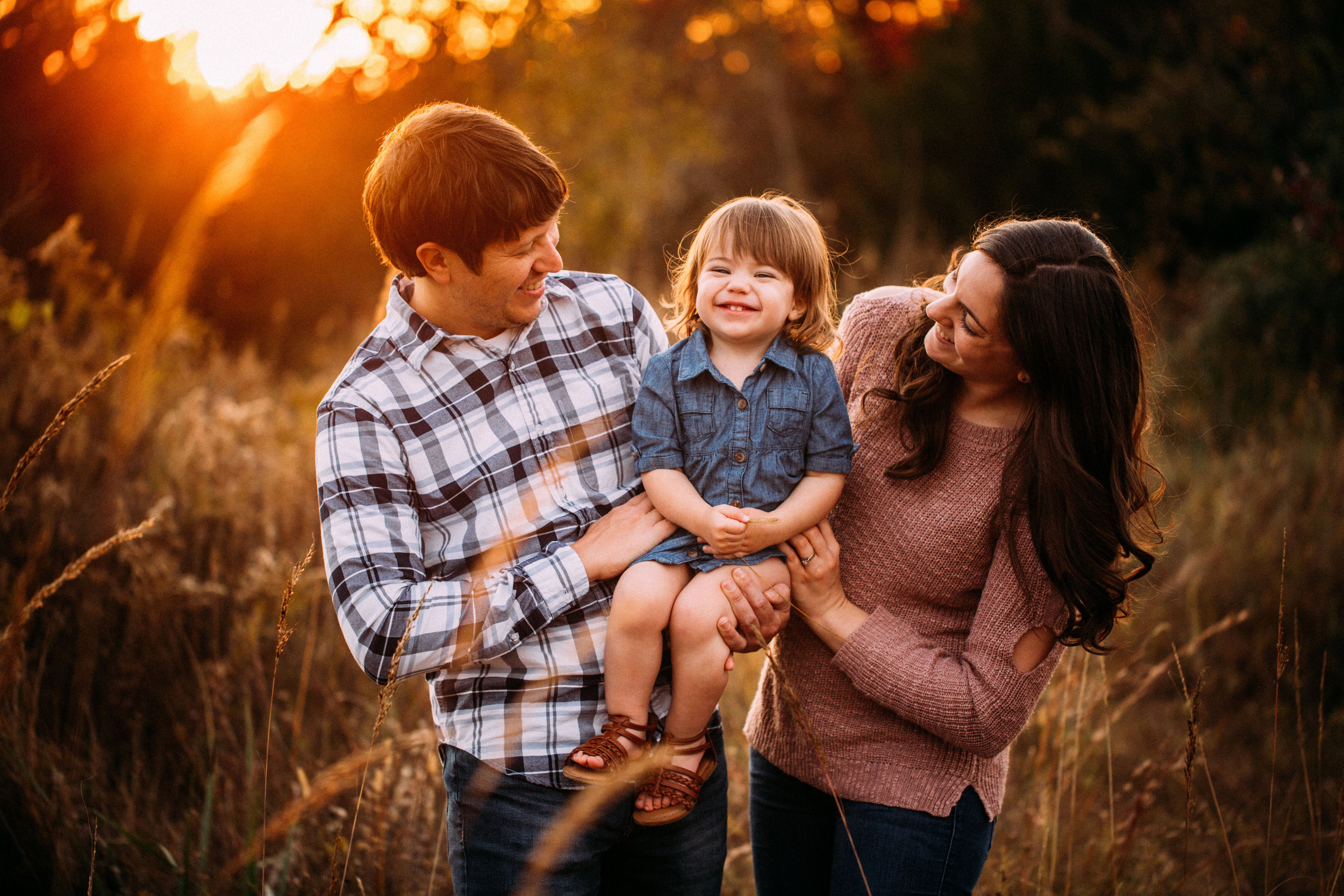 family of 3 laughing