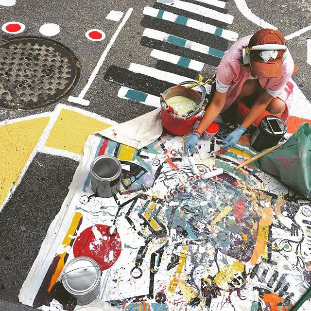 Strawberry Way artist,  Deanna Mance , designed and coordinated installation of the roadway mural.