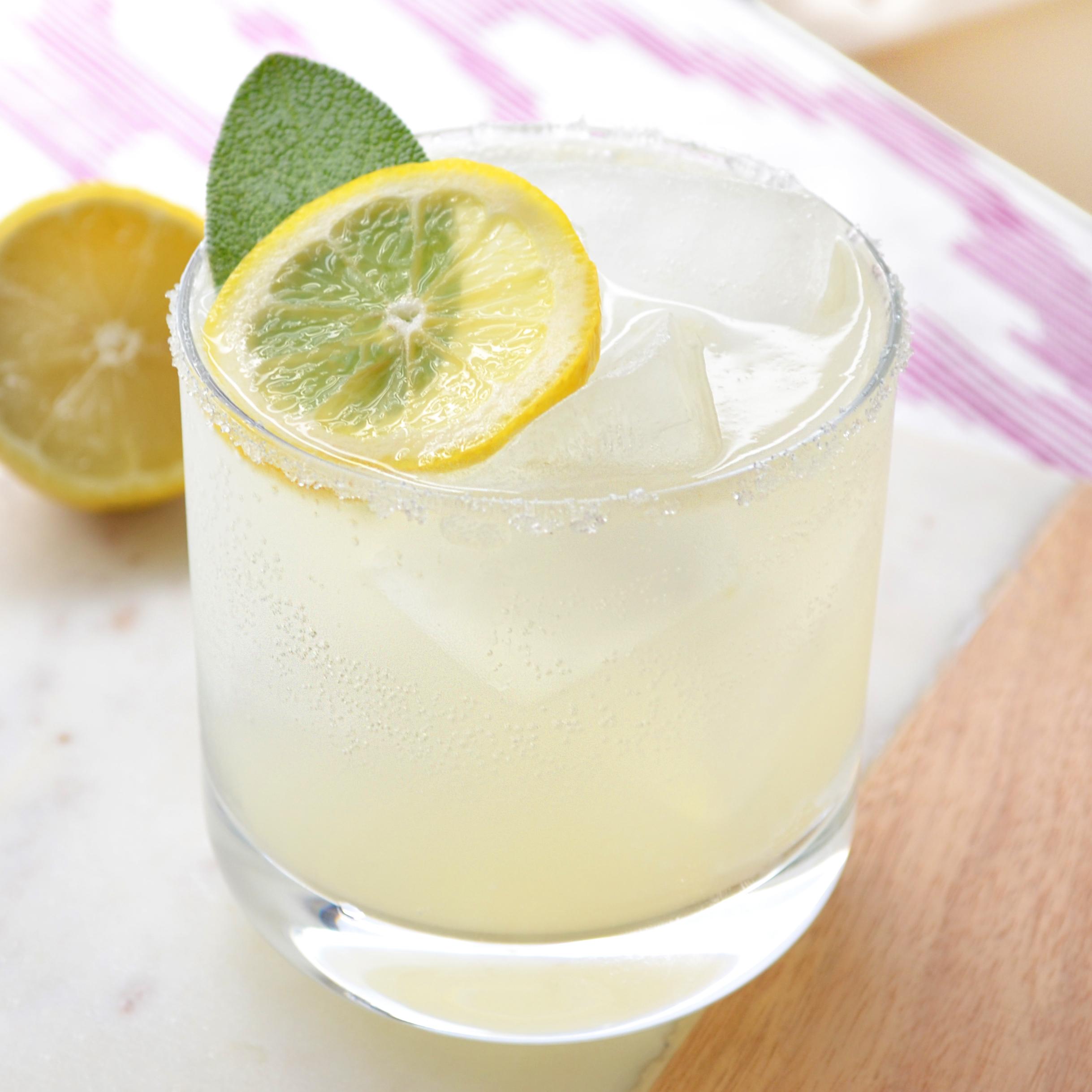 Adults' Only Lemonade    1.5 oz vodka   1 oz sweet and sour   1/2 lemon, freshly-squeezed   ½ oz maple simple syrup  Lemon sparkling water  Sugar for rim    Lemon slice and sage leaf for garnish