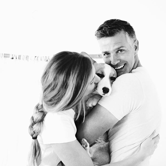 "This is my quirky little family tribe. A pup sMother (think Beverly Goldberg smothering level) + a sweet British hubby with dashing good looks + a sassy corgi called Millie. We do life together - side by side - all day errday. I wouldn't have it any other way. 💕 I'm a full believer in embracing the unique charms that make you YOU! It's easy to compare what your life ""should"" look like to the reality you live in. But the truth is, the real and raw always wins! What's your favorite part about what makes you YOU? I'd love to hear from you! 😘 #jkinstachallenge"