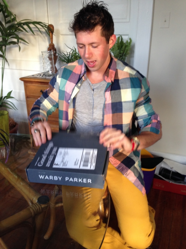 Cazey opening his #WarbyHomeTryOns. You can tell Cazey didn't take this photo because a.) you can see both his hands in the photo and b.) this photo displays Sara's camera's lack of focus. Don't worry, all blurry photos in this post are a result of her camera.