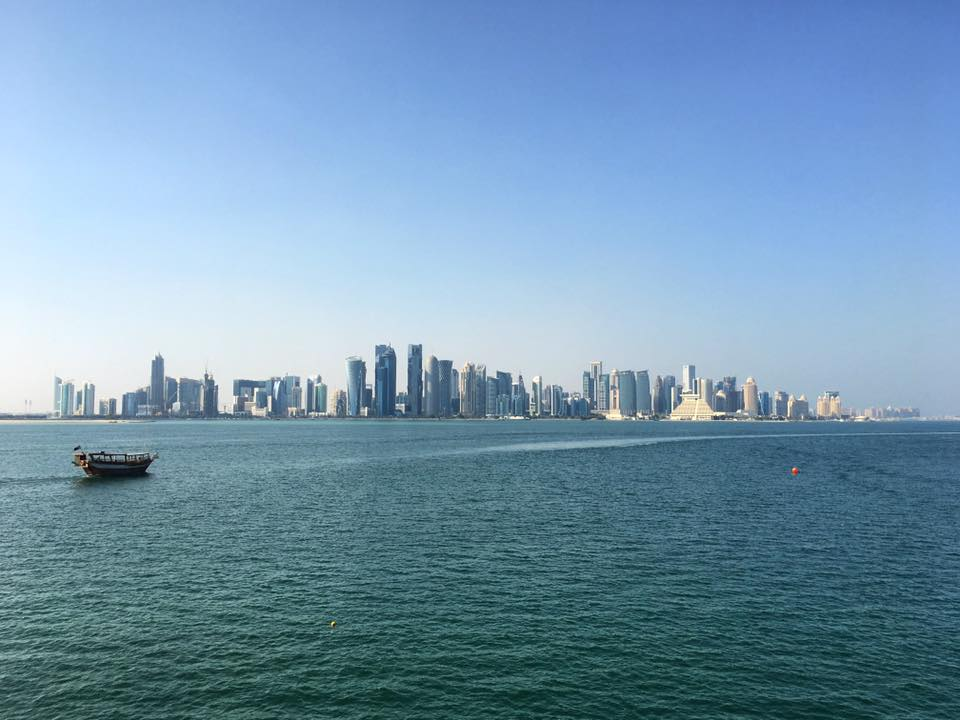 The city skyline over the Persian Gulf.