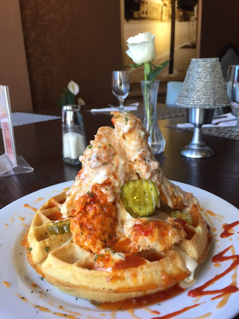 "The Speakeasy Grill's  ""  ' Slap Yo Mama Good' Famous Yardbird & Waffle""  (voted #7 in the nation by Food & Wine magazine)"