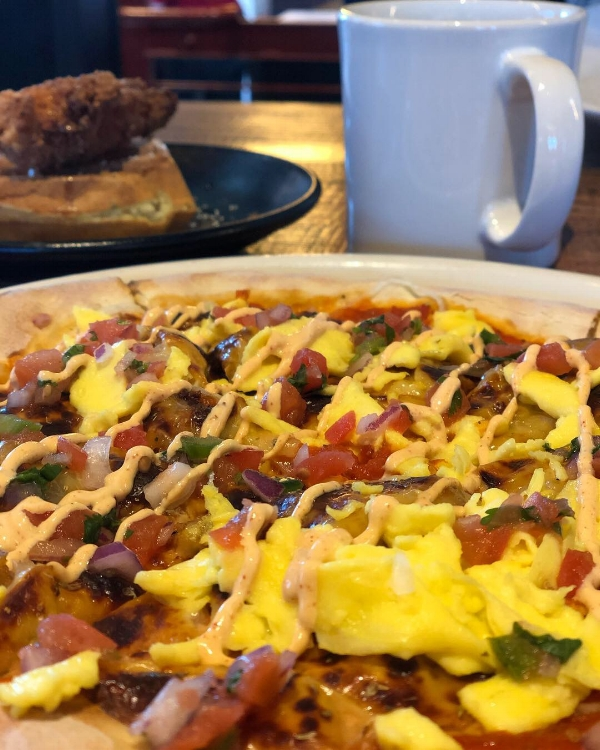 Brunch pizza, coffee, + chicken & waffles. Photo by us.