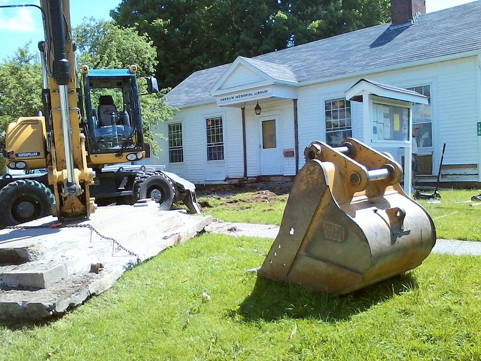 The old porch being taken away, making room for the new one! Photo by Paschal'Simon MacMurray