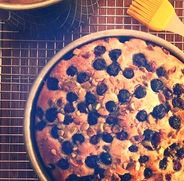 Lemon & Olive oil cake with fresh Blueberries & pistachios finished with chambord simple syrup