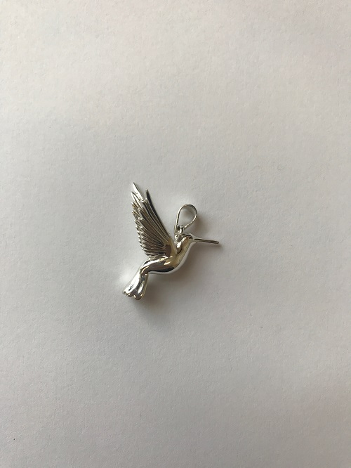 Style #215SS  Sterling silver hummingbird  $110.00