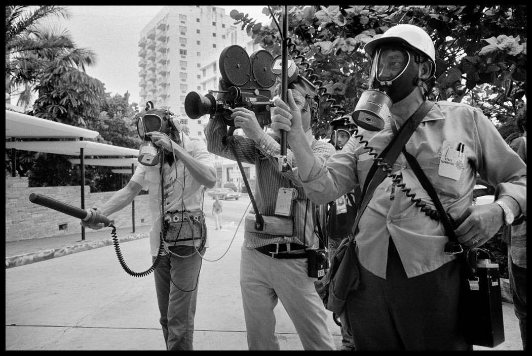 Even the television news crews had to wear gas masks for protection. Photographed by Abbas/Magnum.