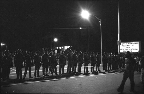 Riot police in the street near the Miami Beach Convention Hall during the 1972 Republican Convention. Photographed by John Buckley.