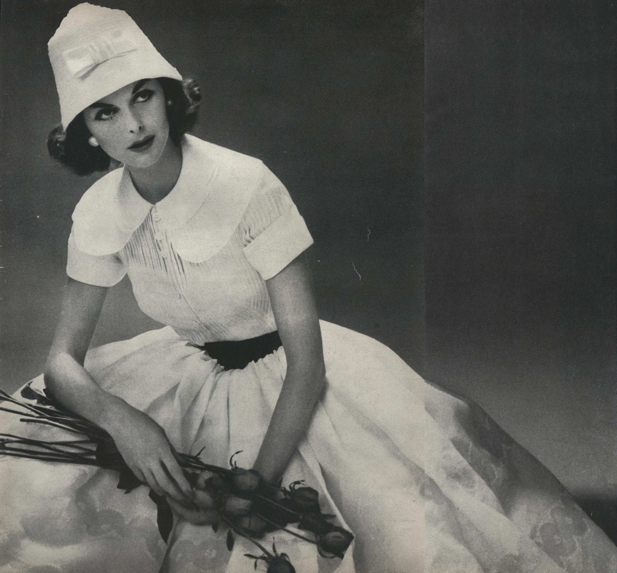 """Galanos was known for his love of stiff white organdie. Here used for a """"demi-long shirtwaist dress that might seen next as a country wedding, or at a dance in town."""" Photographed by Irving Penn for Vogue, June 1957."""