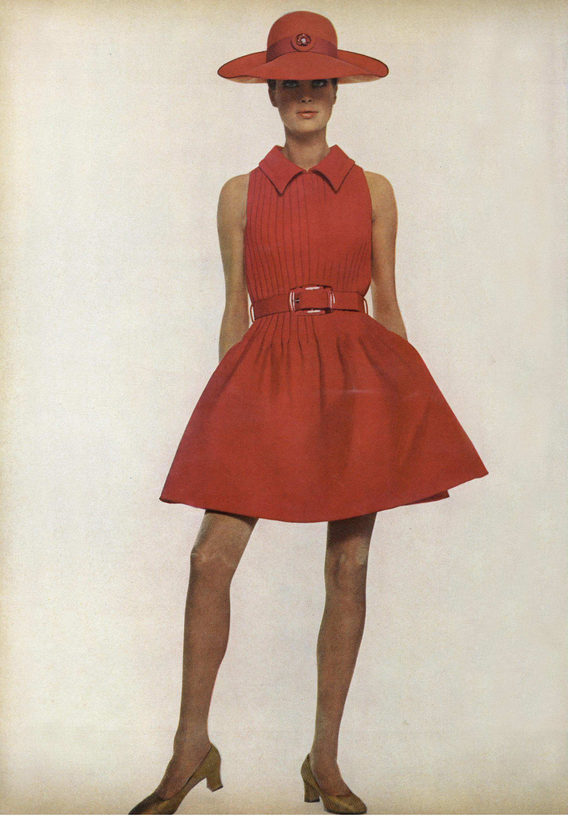 The most darling summer day dress ever: red cotton with a pin-tucked bodice and a full, barrel-pleated short skirt—and of course, the matching hat. Photographed by Jack Penati for  Vogue , April 15, 1968.