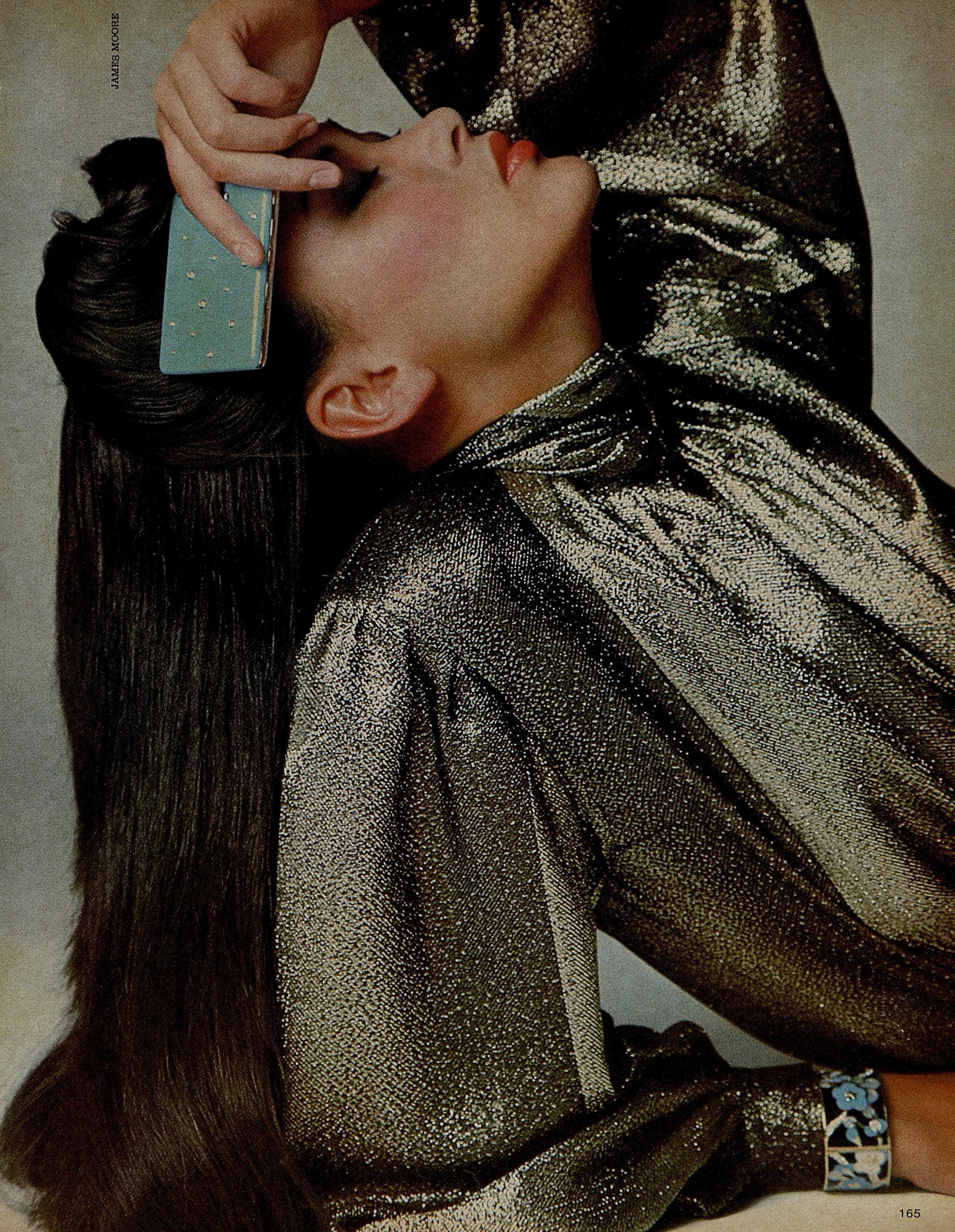 For the disco era, Galanos provided a glittering gold lamé   blouse with broad shoulders. Photographed by James Moore for  Harper's Bazaar , November 1978.